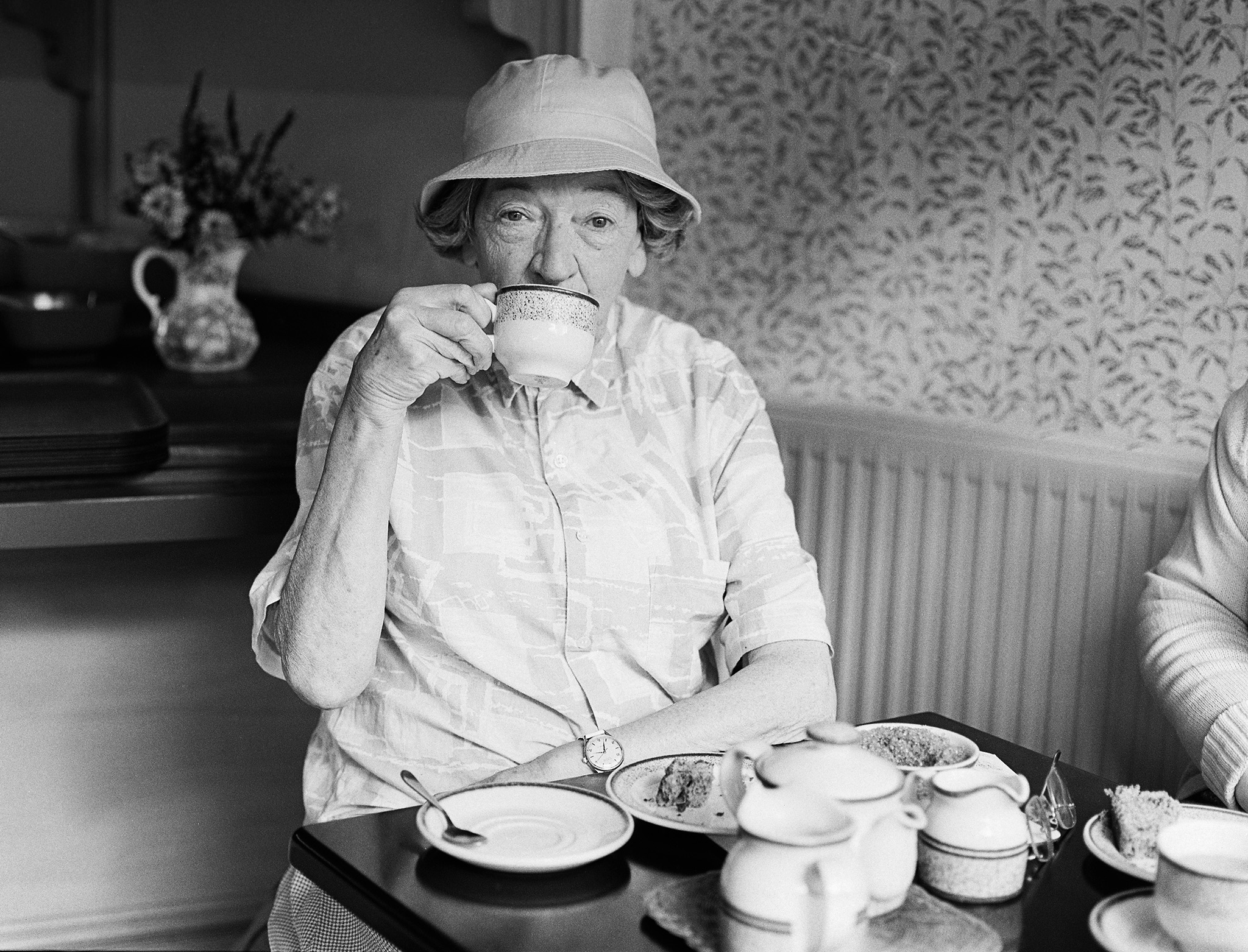 black and white photo of old lady in teashop Salisbury