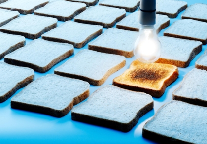 Conceptual image of lightbulb and toast